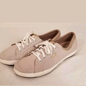 8f95352e592 KEDS Gold Metallic Sequin Champion Sneakers. M 5af792de31a376bc461a2a3d.  Other Shoes you may like. Keds Original Women s Brown   White stripd Canvas